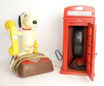 Snoopy BT telephone and another telephone in the form of a red telephone box