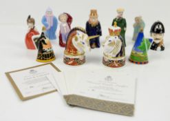 A collection of 24 candle snuffers, primarily Royal Worcester, including Toddie, Policeman and a nun