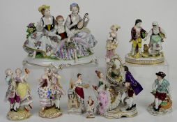 Quantity of Continental porcelain figural groups of courting couples and others, ornately