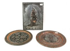 Two circular metal dishes, the larger 38 cm diameter; and a metal plaque of rectangular form, 40 x