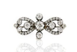 Old cut diamond brooch, central old cut diamond estimated weight 0.61 carats, with four other