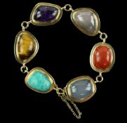 1960's hardstone 'pebble' bracelet, set with vari-shaped cabochons, including tigers eye,
