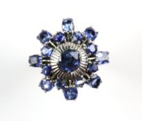 Sapphire dress ring, central oval cut sapphire, high set, with a white metal textured surround, with