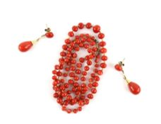 Pair of coral and pearl drop earrings with mounts testing as 14 ct, coral bead single string
