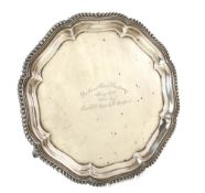George V silver presentation salver with gadrooned serpentine rim on three scroll feet, by S.