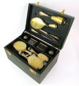 Parcel-gilt silver-plated travel dressing table set, comprising dressing table bottles, brushes,
