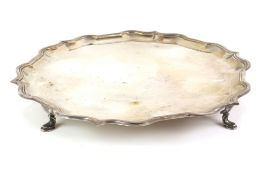 Modern silver salver, with shaped border on four flattened hoof feet, by Roberts & Belk Ltd.,