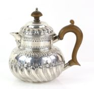 George III silver teapot with embossed and gadrooned decoration, maker's mark 'IB', London, 1802,