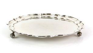 Modern silver salver with pie crust border on three scroll feet, by E P & Co., Sheffield, 1966, 17.