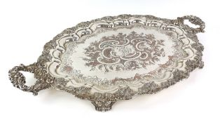 Silver plated presentation twin-handled tray with moulded grapevine decoration on four scroll