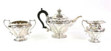 AMENDED DESCRIPTION Edward VII silver three piece tea service, comprising teapot, cream jug and