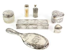 Edward VII silver box, the sides and cover chased with leisure scenes and cherubs, import marks