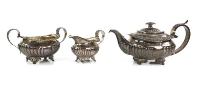 Near matched George III/Victorian silver three piece tea service, comprising teapot, cream jug and