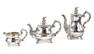 Victorian silver three piece tea service, comprising tea pot, hot water jug and cream jug, with