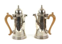 George V pair of silver chocolate pots, each with plain tapering bodies and wooden handles, by C S