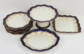 Late 19th/early 20th century dessert service with cobalt blue border, gilt bows and swags with a
