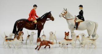 Beswick Huntsman and Huntswoman, 20cm, together with 9 foxhounds and two foxes