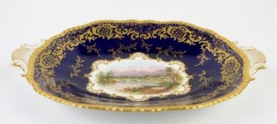 Coalport oval two handled dish in cobalt with gilt decoration, the centre hand-painted with a