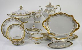 Weimar porcelain dinner service for 12, decorated in gilt with a band of scrolling leaves and
