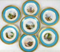 Minton part dessert service each piece painted with a Scenic view within turquoise and gilt tooled