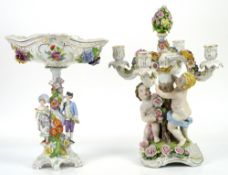 German porcelain four light candelabra the central trunk held up by two putti, 46cm and a Dresden