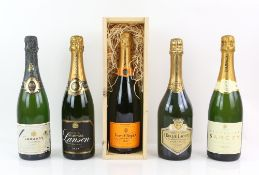 Nine bottles of Champagne to include one bottle of Veuve Clicquot Brut Champange in wooden case; one