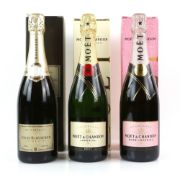 Three bottles of champagne in presentation boxes, to include one bottle of Moet & Chandon 'Moet