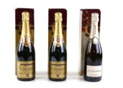 Three bottles of Louis Roederer Champagne, Brut Premier, boxed Stored in a wine cooler in a garage