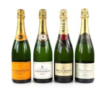 Four bottles of champagne, to include one bottle of Pierre Darcys Brut Champagne, one bottle of Moet