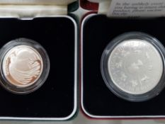 2 SILVER PROOF SILVER COINS INCLUDES 1995 2 POUND WWII COIN AND 1993 5 POUND SILVER COIN IN ORIGINAL