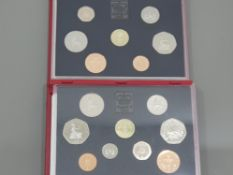 2 SETS OF COINS 1985 PROOF DELUXE LEATHER CASE PLUS ORIGINAL PACKING CONTAINING X 7 C.O.A AND A 1986