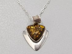 SILVER AND GREEN AMBER PENDANT AND CHAIN