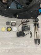 CAMERA EQUIPMENT INCLUDING CLUBMAN TRIPOD NIKON CAMERA L35AD2 CANON SPRINT CAMERA IN A BAG