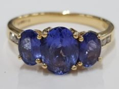 18CT YELLOW GOLD AND TANZANITE SET RING, CLARITY VS, COLOUR AAA MINIMUM, OVAL SHAPED CUT WITH