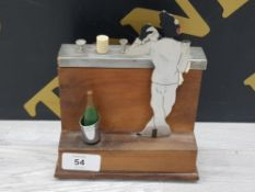MID 20TH CENTURY CIGARETTE DISPENSER IN THE FORM OF A BARTENDER WITH MUSICAL TUNE WHEN OPENED,