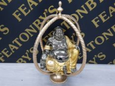 A LARGE BUDDHA WITH GILT STAND