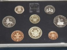 8 UK PROOF 1986 YEARLY SET IN A BLUE CASE, B UNC IN ORIGINAL PACKING C.O.A