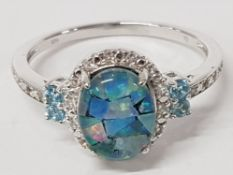 A SILVER DOUBLET OPAL BLUE AND WHITE STONE RING STAMPED SIZE U 2.6G GROSS