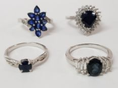 FOUR SILVER AND BLUE STONE RINGS STAMPED SIZES R 1/2 AND S 15.4G GROSS