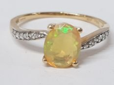 A 9CT YELLOW GOLD OPAL AND WHITE STONE RING SIZE R 1/2 2.3G GROSS