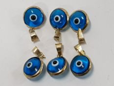 6 EVIL EYE CHARMS MOUNTED IN 8CT TURKISH GOLD 333