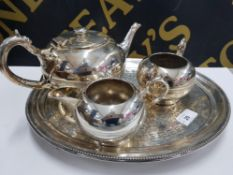 THREE PIECE SILVER ON BRITANNIA METAL BULLET SHAPED TEA SET BY WALKER AND HALL ON FOOTED ANTIQUE