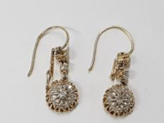 15CT YELLOW GOLD AND DIAMOND DROP EARRINGS COMPRISING OF TWO ROUND OLD CUT DIAMONDS AND A CLUSTER OF