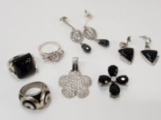3 SILVER RINGS (ONYX, ENAMEL AND WHITE STONE) 2 SILVER PENDANTS (WHITE AND BLACK STONE) 2 PAIRS
