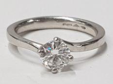 LADIES PLATINUM DIAMOND SOLITAIRE RING COMPRISING OF A SINGLE ROUND BRILLIANT CUT DIAMOND, SET IN