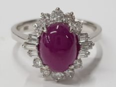 LADIES 14CT WHITE GOLD CABOCHON RUBY AND DIAMOND CLUSTER RING COMPRISING OF A SINGLE OVAL CUT