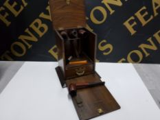 AN OAK PIPE SMOKER'S DROP FRONT CASE WITH ONE INTERNAL DRAWER TOGETHER WITH THREE ESTATE PIPES BY