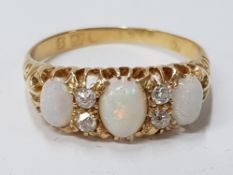 LADIES 18CT ANTIQUE OPAL AND DIAMOND RING COMPRISING OF THREE OVAL CUT OPALS, COMPLETE WITH TWO