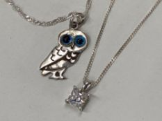 SILVER OWL WITH GLASS EYES PENDANT ON DOUBLE LINK TWISTED 19'' CHAIN TOGETHER WITH A SILVER CAGED