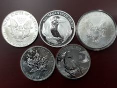 5 SILVER ONE OUNCE COINS COMPRISING USA 1986 AND 2011, AUSTRALIA 2012, CANADA 2011 AND UK 2014,